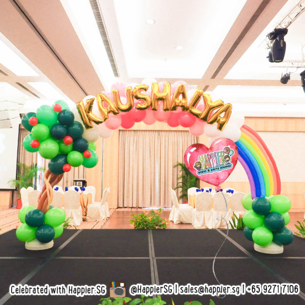 Customised rainbow balloon arch