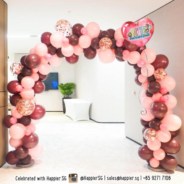 Maroon pink organic balloon arch