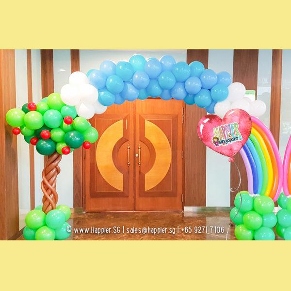 Rainbow garden balloon arch