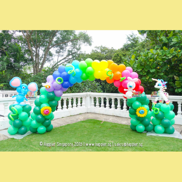 Rainbow garden balloon arch